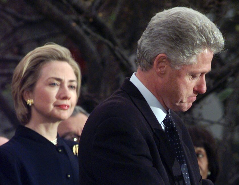 FILE - In this Dec. 19, 1998 file photo, First lady Hillary Rodham Clinton watches President Clinton pause as he thanks those Democratic members of the House of Representatives who voted against impeachment. The long-running drama of Hillary Clinton's marriage _ her husband's infidelity and how she dealt with it _ is back as a subtext in this year's presidential race. (AP Photo/Susan Walsh)