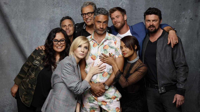 "Rachel House, Mark Ruffalo, Cate Blanchett, Jeff Goldblum, Taika Waititi, Chris Hemsworth, Tessa Thompson, and Karl Urban, from the film ""Thor: Ragnarok."""