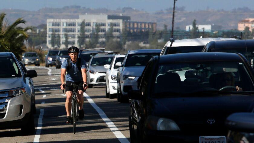 LOS ANGELES, CA. -- Thursday, June 15, 2017: Tom Krenzke, 35, uses a bike lane during his commute i