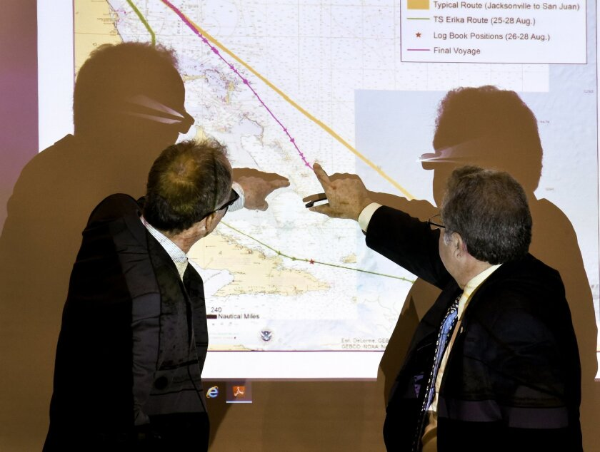 Baird, former second mate of the El Faro, left,  and Mike Kucharski with the National Transportation Safety Board discuss route options available to the El Faro when dealing with the approaching hurricane during a hearing investigating the ship's sinking last October, Thursday, Feb. 18, 2016, in Ja