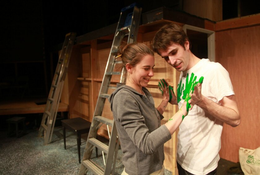 """Rachael VanWormer and Kyle Lucy rehearse a scene from New Village Arts Theatre's """"Waving Goodbye."""""""