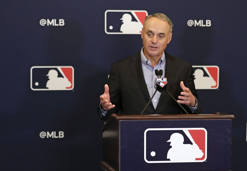 MLB commissioner Rob Manfred speaks to reporters in Arlington, Texas.