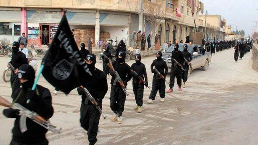 Islamic State fighters march in Raqqa, Syria.