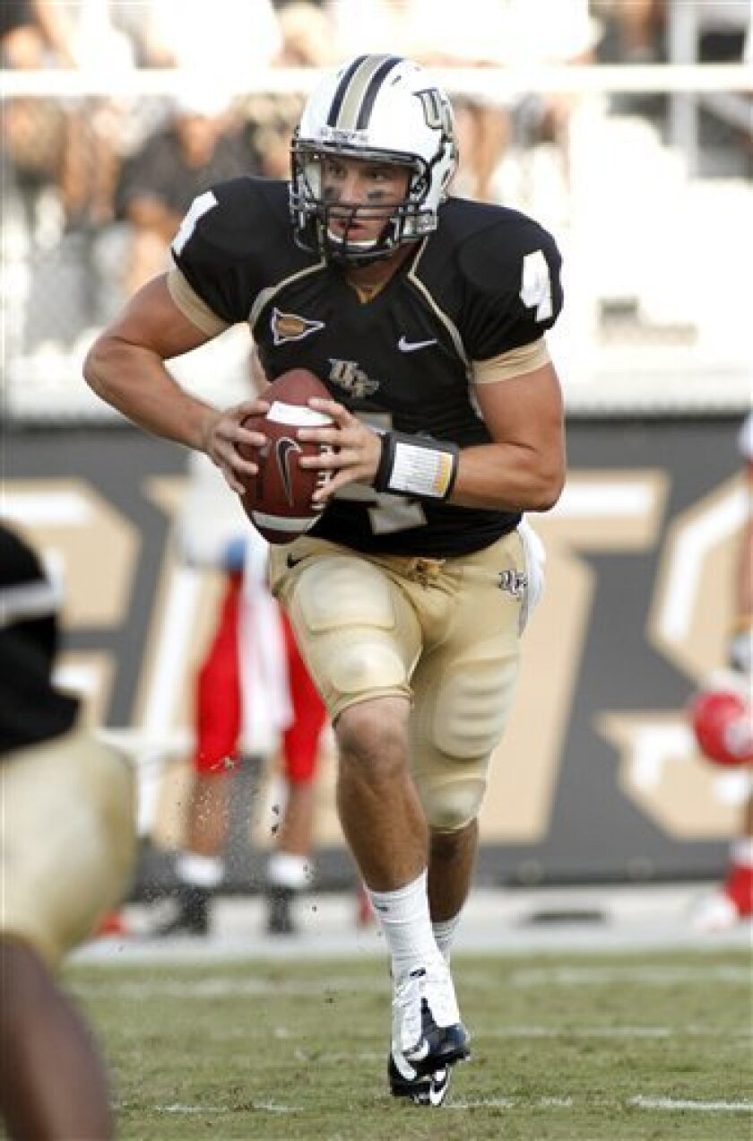 FILE - In this Sept. 4, 2010, file photo, Central Florida quarterback Rob Calabrese (4) rols out during an NCAA college football game against South Dakota in Orlando, Fla. Central Florida hosts UAB on Wednesday. (AP Photo/Reinhold Matay, File)