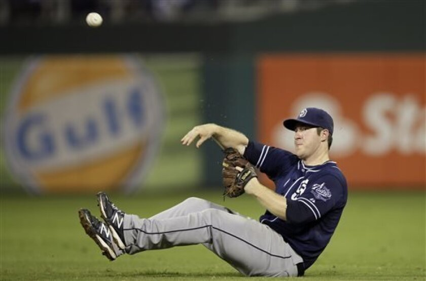 San Diego Padres second baseman Jedd Gyorko throws to first base after fielding a groundrt by Philadelphia Phillies' Chase Utley during the seventh inning of a baseball game, Tuesday, Sept. 10, 2013, in Philadelphia. Utley was out. San Diego won 8-2. (AP Photo/Matt Slocum)