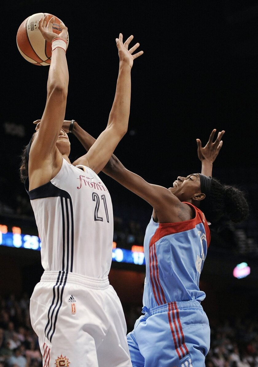 Atlanta Dream's Tiffany Hayes, right, fouls Connecticut Sun's Jennifer Lacy during the second half of a WNBA basketball game, Sunday, Aug. 23, 2015, in Uncasville, Conn. The Dream won 102-92. (AP Photo/Jessica Hill)