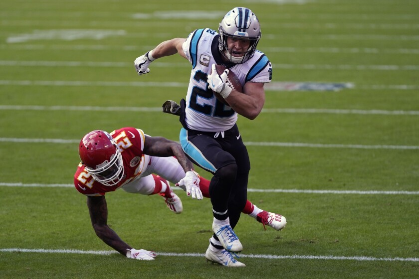 FILE - Carolina Panthers running back Christian McCaffrey (22) runs past Kansas City Chiefs cornerback Bashaud Breeland (21) during the second half of an NFL football game in Kansas City, Mo., in this Sunday, Nov. 8, 2020, file photo. It has been a long, frustrating season for 2019 All-Pro running back Christian McCaffrey. But the Panthers star is ready to return for the final four games of the season after missing nine games this season with ankle and shoulder injuries (AP Photo/Jeff Roberson, File)