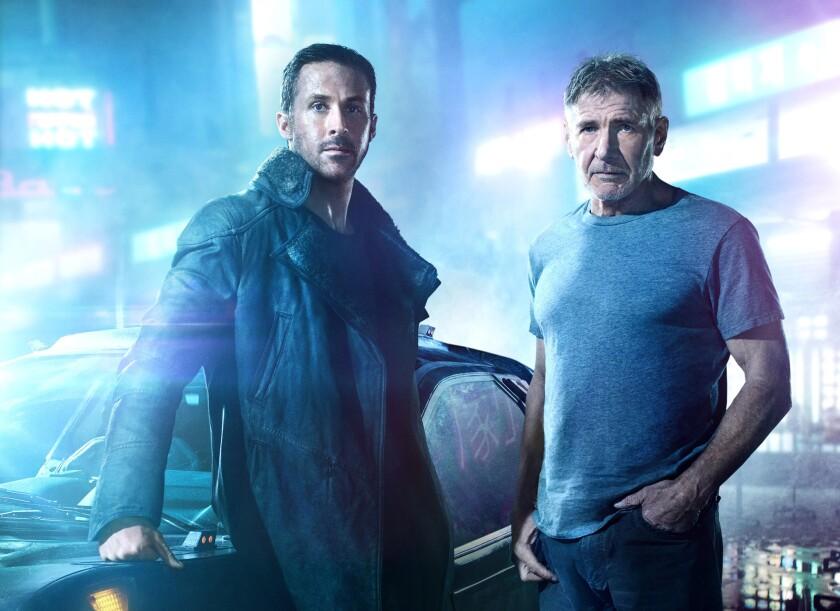 """Ryan Gosling, left, stars as Officer K and Harrison Ford returns as Rick Deckard in """"Blade Runner 2049."""""""