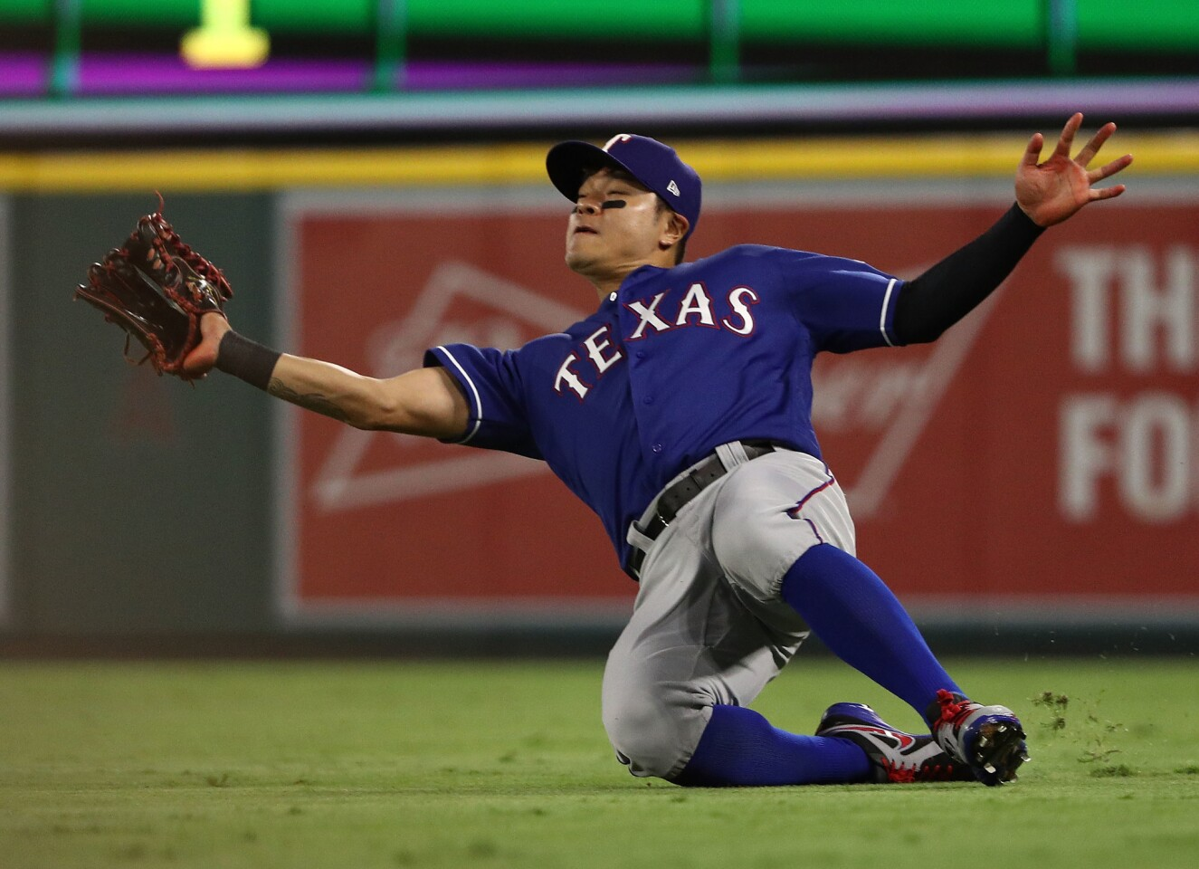 ANAHEIM, CA - SEPTEMBER 10: Shin-Soo Choo #17 of the Texas Rangers makes a sliding catch on a flyball to right field during the fourth inning of the MLB game at Angel Stadium on September 10, 2018 in Anaheim, California. (Photo by Victor Decolongon/Getty Images) ** OUTS - ELSENT, FPG, CM - OUTS * NM, PH, VA if sourced by CT, LA or MoD **