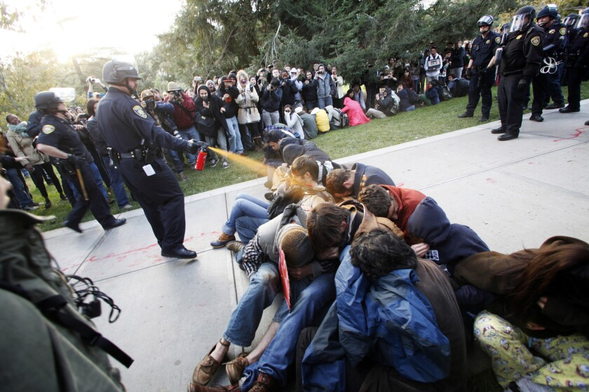 University of California Davis police Lt. John Pike douses student protesters with pepper spray in 2011.