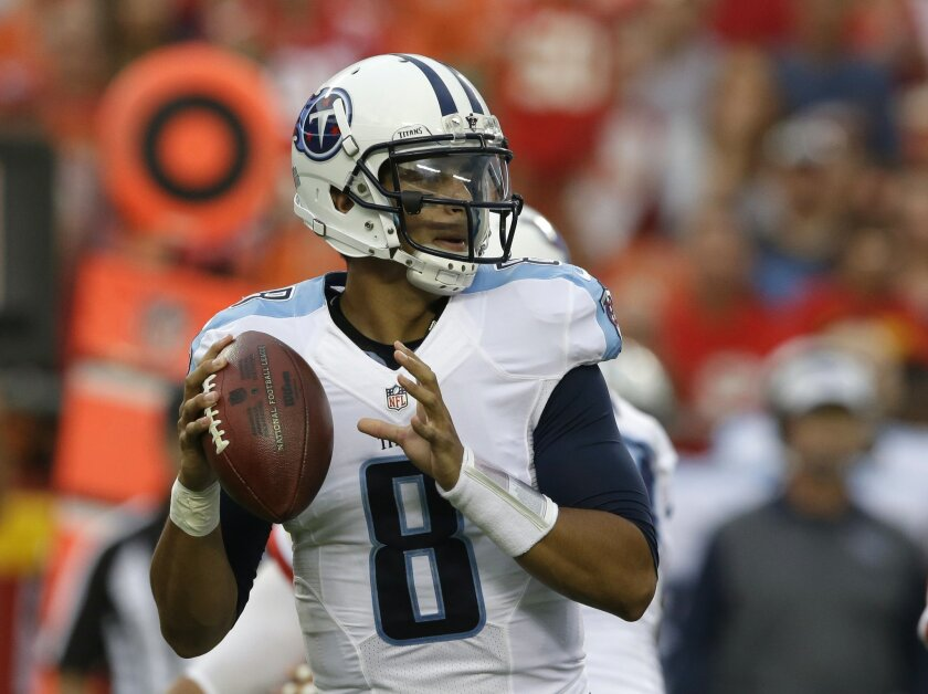 Tennessee Titans quarterback Marcus Mariota (8) prepares to throw during the first half of a preseason NFL football game against the Kansas City Chiefs at Arrowhead Stadium in Kansas City, Mo., Friday, Aug. 28, 2015. (AP Photo/Orlin Wagner)