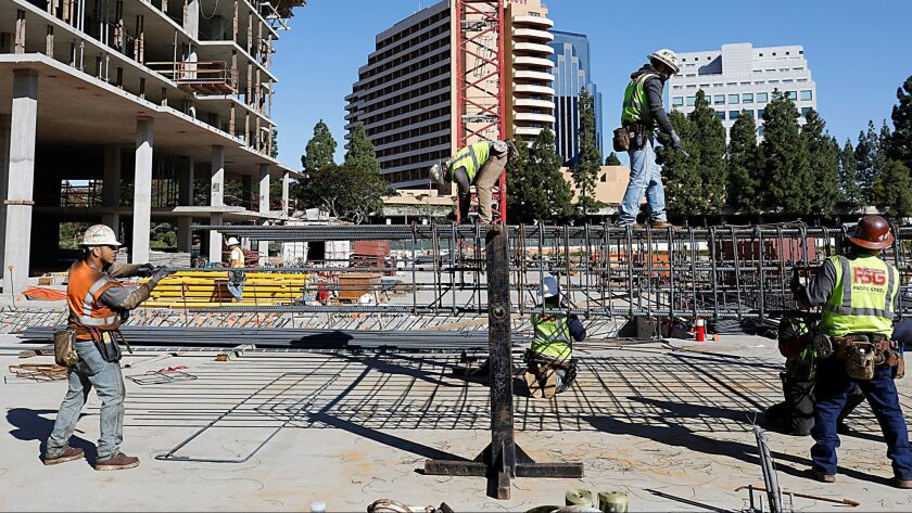 Construction has added the most year-over-year with 6,300 jobs. Pictured: Local 229 ironworkers build a rebar column near what will become a Garden Communities residential high-rise on La Jolla Village Drive.