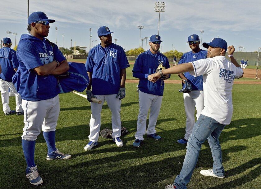Professional boxer Victor Ortiz, right, a native of Garden City, Kan., visits with Kansas City Royals players Salvador Perez, Lorenzo Cain, Mike Moustakas and Alcides Escobar, from left, at the team's spring training facility before the Royals' baseball game against the Los Angeles Dodgers on Tuesday, March 22, 2016, in Surprise, Ariz. (John Sleezer/The Kansas City Star via AP)