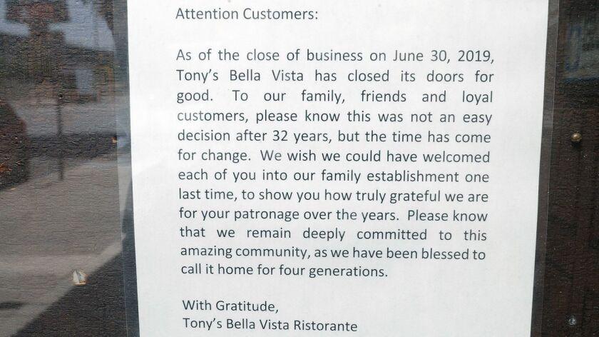 A notice in the menu case at Tony's Bella Vista Ristorante on the 3100 block of Magnolia Blvd. in Bu
