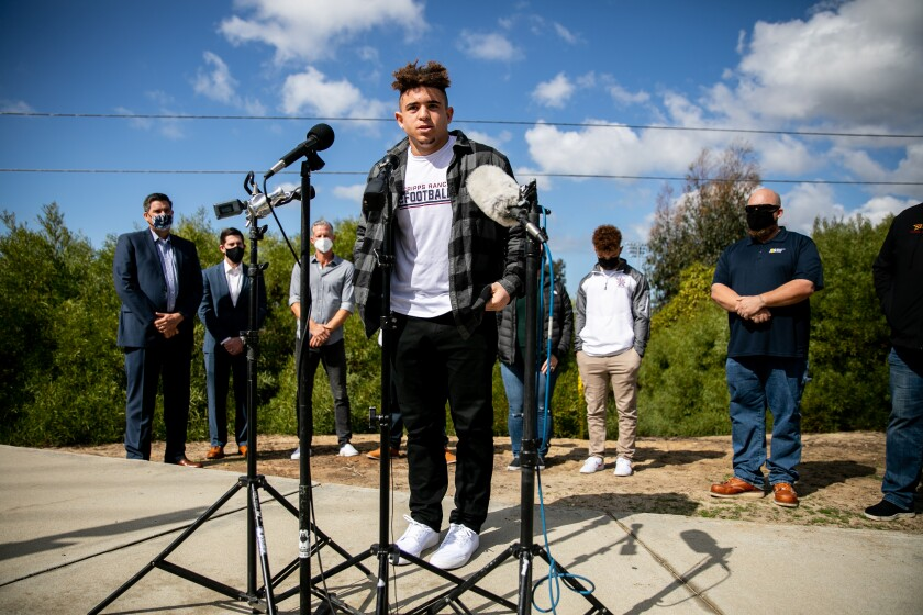 Nicholas Gardinera, a senior at Scripps Ranch High School, speaks at a news conference at Torrey Highlands Park