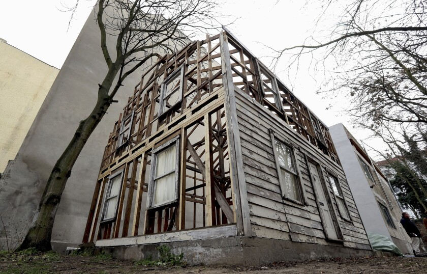FILE - This Dec. 12, 2017 file photo shows the rebuilt house of the civil rights activist Rosa Parks in Berlin, Germany. The rundown, paint-chipped Detroit house where U.S. civil rights campaigner Rosa Parks took refuge after her historic bus boycott is going on display on Tuesday, Sept. 15, 2020 in Italy in a setting that couldn't be more incongruous: the imposing central courtyard of the 18th century Royal Palace in Naples, southern Italy. (AP Photo/Michael Sohn, file)