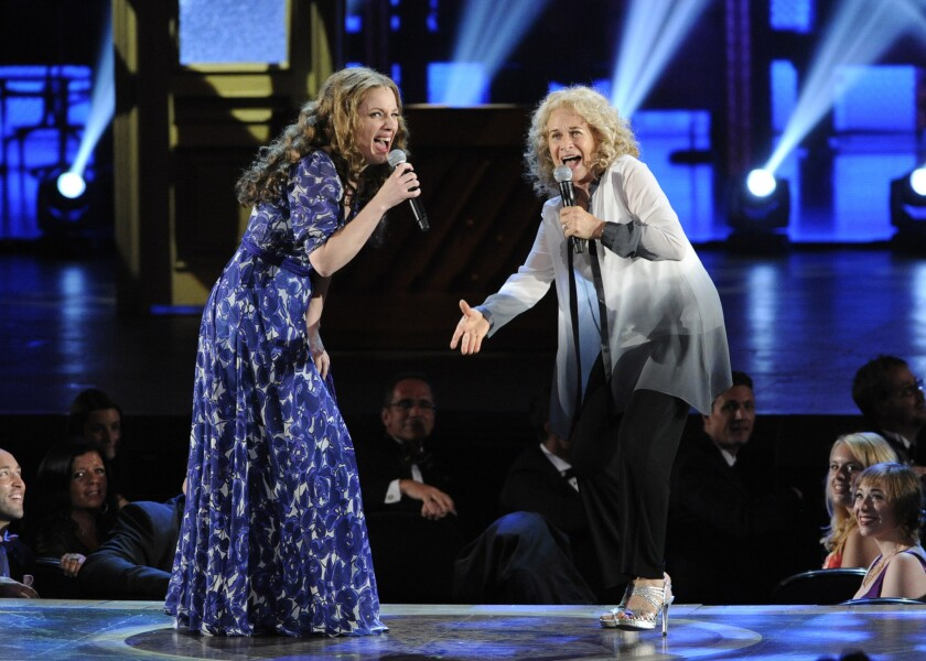 """Carole King, right, sings with Jessie Mueller, star of """"Beautiful: The Carole King Musical,"""" at the 68th annual Tony Awards."""