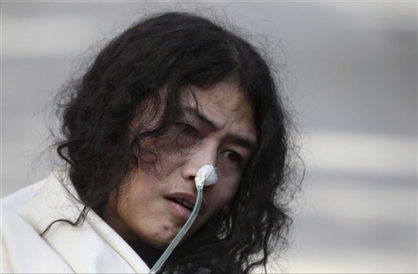 India's Irom Sharmila, who has been on a hunger strike for 12 years to protest an Indian law that suspends many human rights protections in areas of conflict, speaks during a press conference, in New Delhi, India, Monday, March 4, 2013. Sharmila who has been force fed through a tube by authorities was charged Monday with attempted suicide in a case likely to bring major attention to her quiet protest in the tiny northeastern state of Manipur against the Armed Forces Special Powers Act. (AP Pho