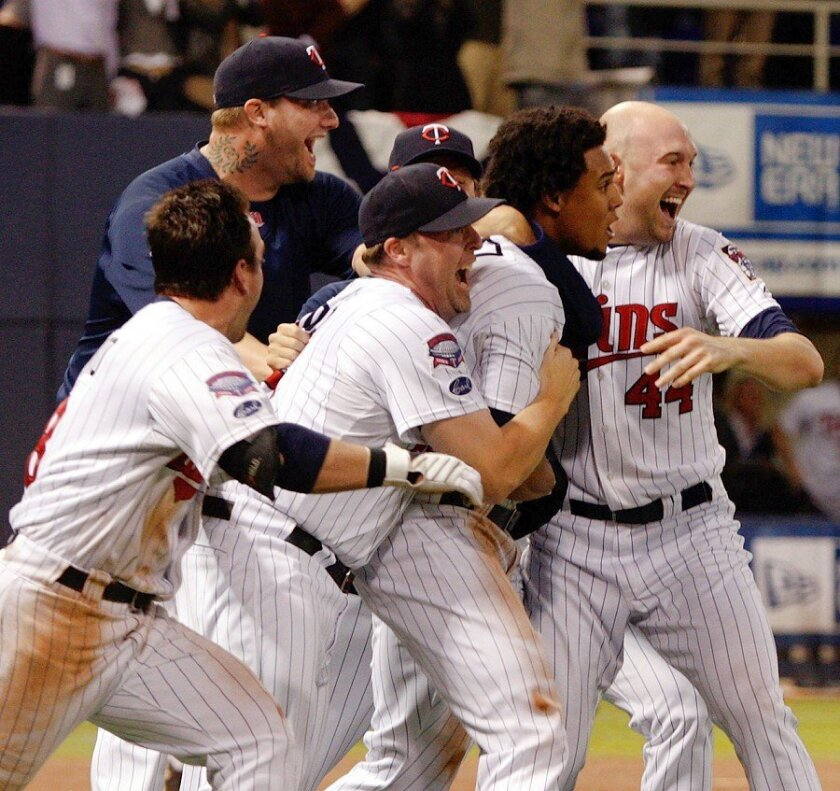 The Minnesota Twins celebrate after Alexi Casilla singled home the winning run with one out in the 12th inning to beat the Detroit Tigers 6-5 in the AL Central tiebreaker. The Yankees are next. Jamie Squire / Getty Images