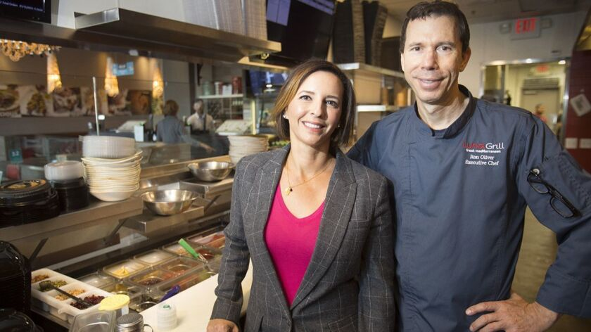 Maria Trakas Pourteymour and Ron Oliver in the kitchen at Luna Grill's Scripps Ranch location.