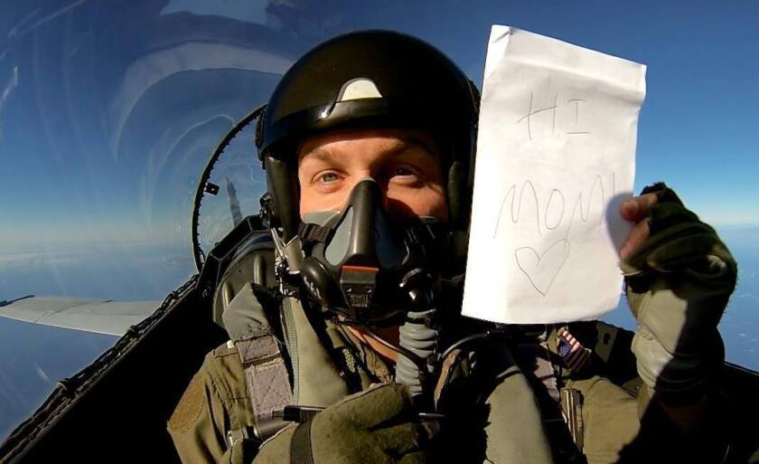 "Navy pilot Nathan Poloski of Lake Arrowhead took a photo of himself with a sign reading ""Hi Mom!"" during his first solo flight in December 2012."