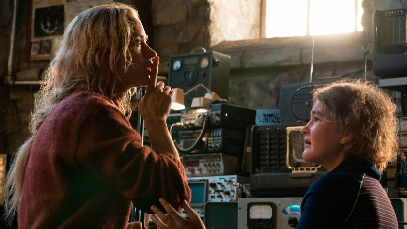 This image released by Paramount Pictures shows Emily Blunt, left, and Millicent Simmonds in a scene