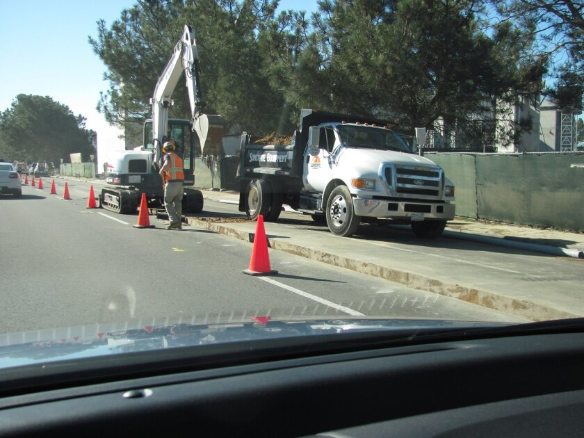 Utility trenches along Torrey Pines Road have blocked some traffic lanes for the past two weeks.