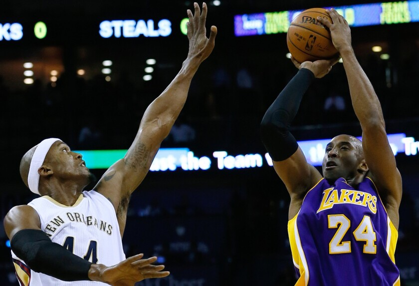 Lakers guard Kobe Bryant shoots over Pelicans forward Dante Cunningham during the first half.