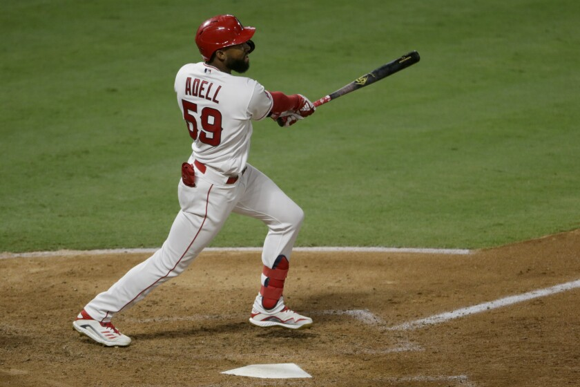 The Angels' Jo Adell hits a sixth-inning home run against the Seattle Mariners on Aug. 29, 2020.