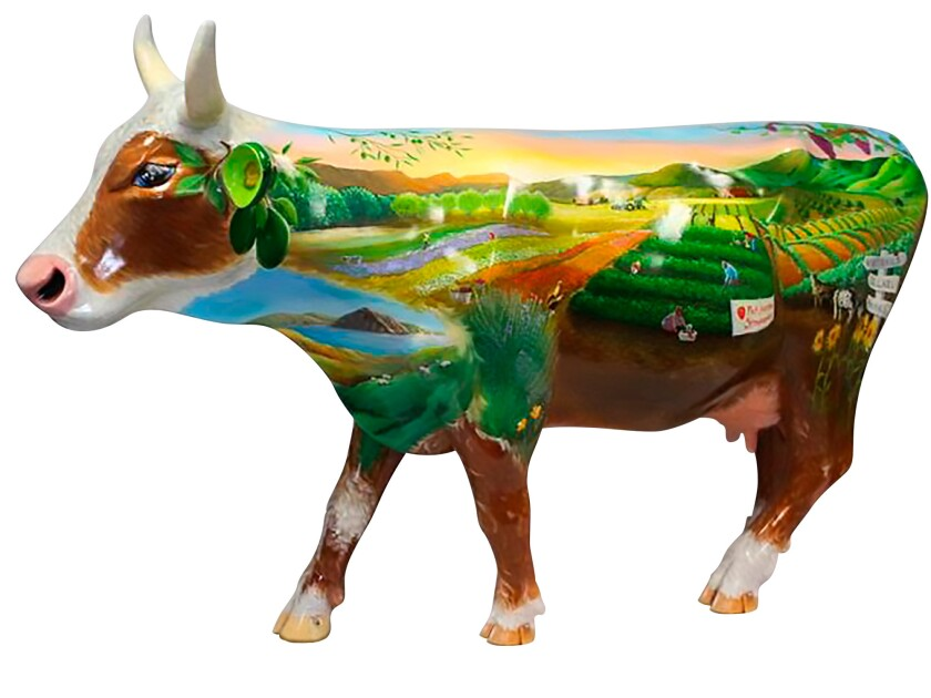 """""""Moo'ving Through the Decades of Agriculture,"""" created by artist Linn Mercer for CowParade SLO County."""