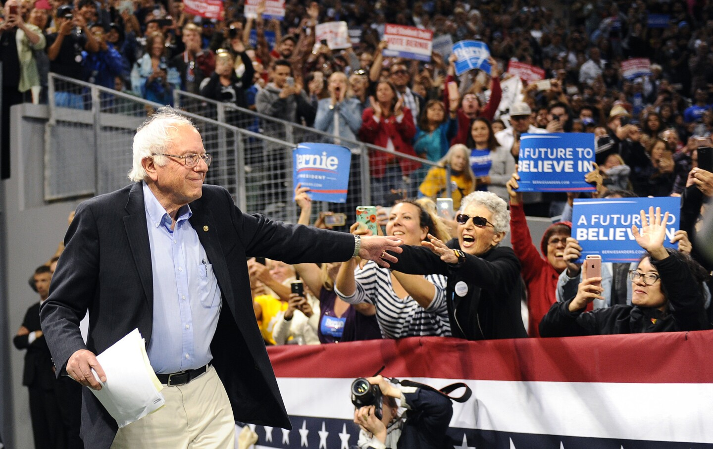 Democratic presidential candidate Bernie Sanders waves to supporters Tuesday night at StubHub Center in Carson, Calif.