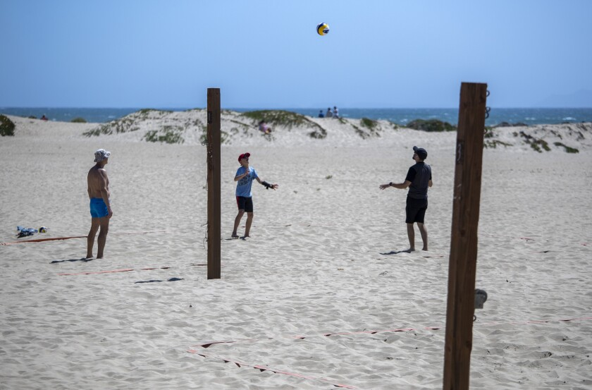 Beachgoers hit a volleyball around at Harbor Cove Beach in Ventura on May 2.