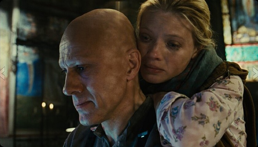 "Melanie Thierry, right, and Christoph Waltz star in ""The Zero Theorem."""