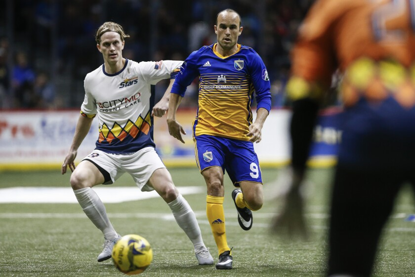 San Diego Sockers forward Landon Donovan (9) battles for posession with Tacoma Stars midfielder Philip Lund in the third period of a Feb. 15 game at Pechanga Arena.