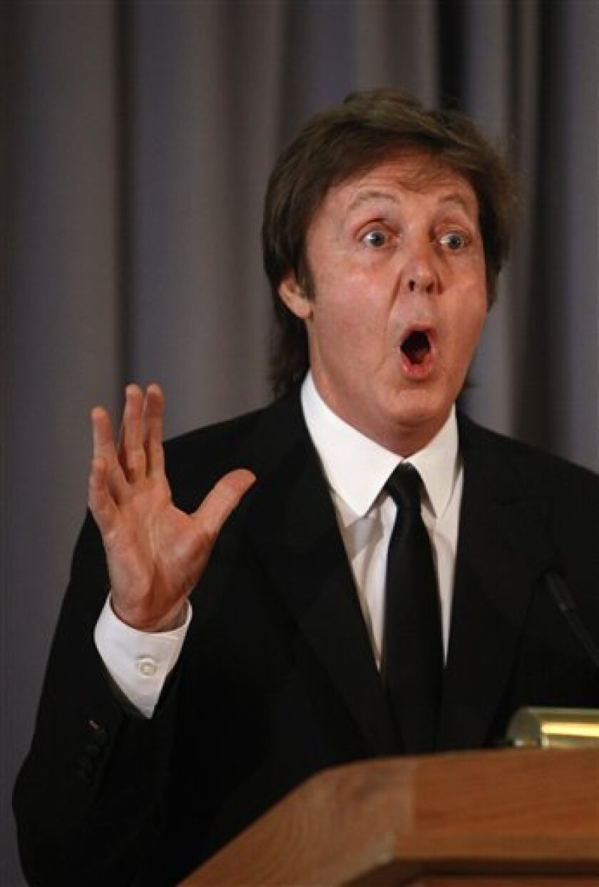 Singer Paul McCartney speaks to the media about his being awarded the Library of Congress Gershwin Prize for Popular Song in Washington, on Tuesday, June 1, 2010. (AP Photo/Jacquelyn Martin)