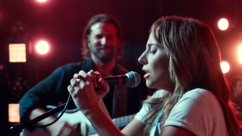 "(L-R) - Bradly Cooper and Lady Gaga in a scene from ""A Star is Born."" Credit: Warner Bros. Pictures"