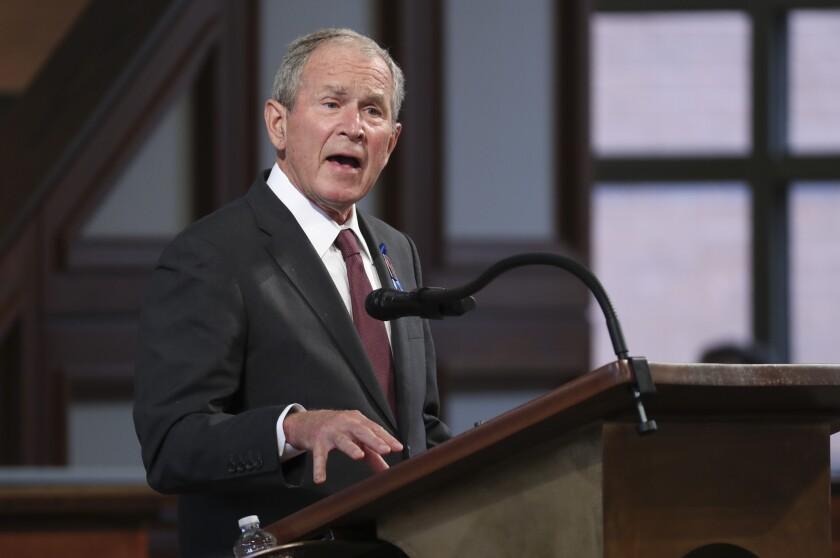 George W. Bush speaks at a lectern