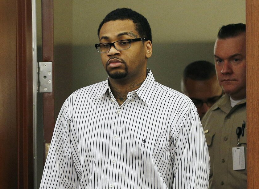FILE - In this Monday, Oct. 12, 2015 file photo, Ammar Asim Faruq Harris walks into court in Las Vegas.  A jury decided Wednesday, Nov. 4, 2015, that the 29-year-old self-styled pimp should be sentenced to death for killing three people by opening fire into a moving vehicle after a dispute at a hip