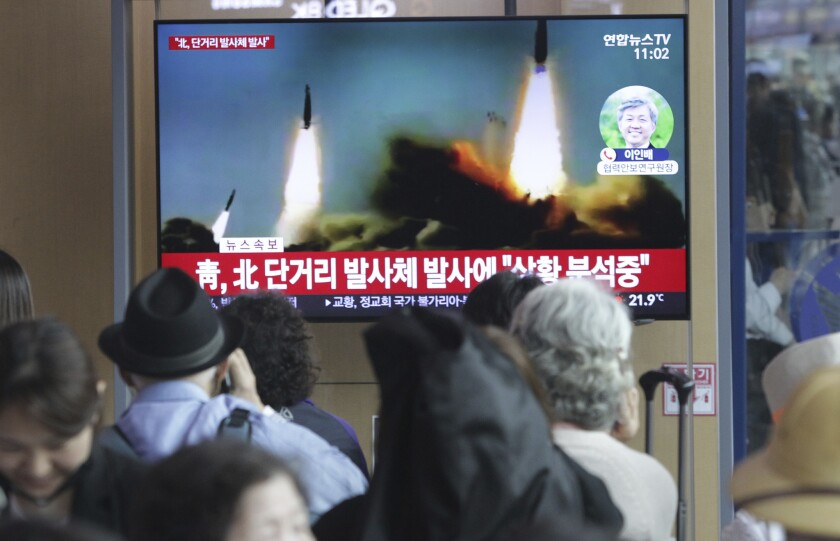 People in Seoul watch a TV news program showing file footage of a North Korean missile launch. North Korea on Saturday fired several unidentified short-range projectiles into the sea off its eastern coast, according to the South Korean military.