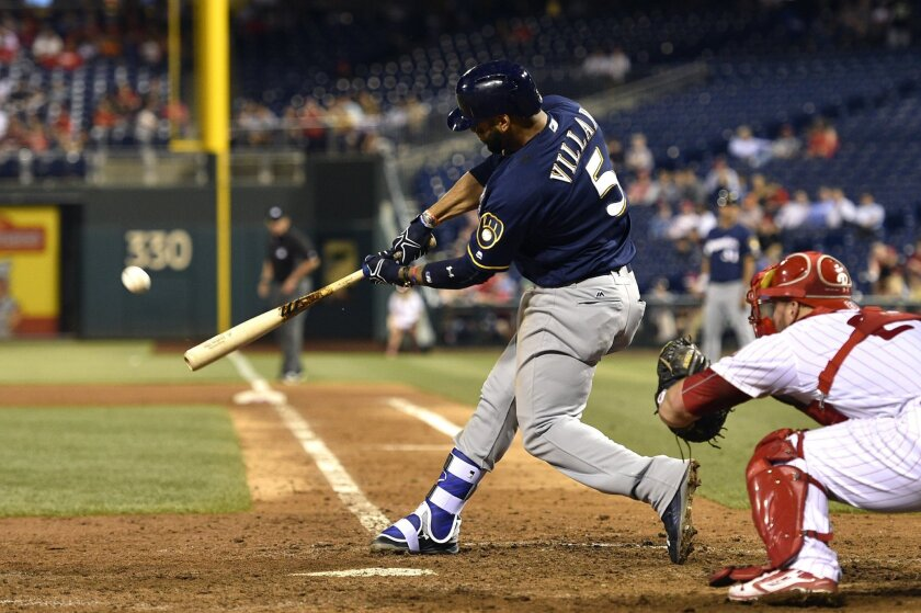 Milwaukee Brewers' Jonathan Villar hits a two-run home run off Philadelphia Phillies relief pitcher Jeanmar Gomez during the ninth inning of a baseball game Thursday, June 2, 2016, in Philadelphia. The Brewers won 4-1. (AP Photo/Derik Hamilton)