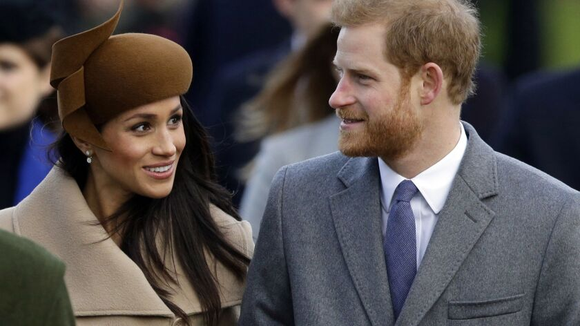 FILE - In this Monday, Dec. 25, 2017 file photo, Britain's Prince Harry and his fiancee Meghan Markl