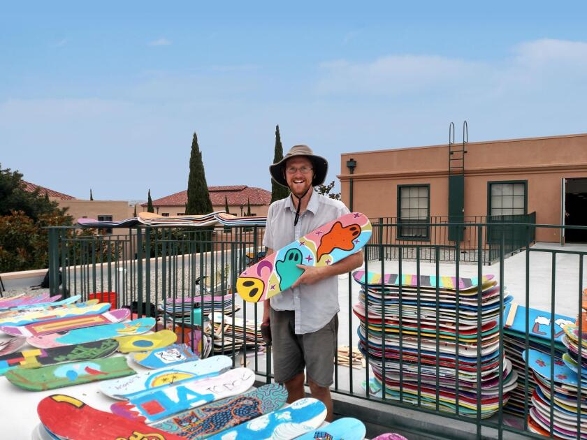 Jeremy Nuttall in the midst of his 'Rolling It Forward' project made of community-contributed skateboards