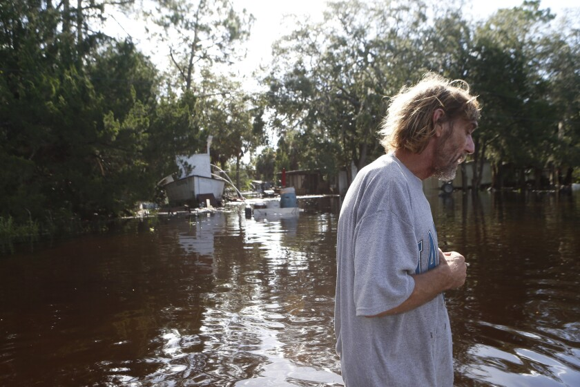 A resident surveys damage around his home from high winds and storm surge associated with Hurricane Hermine which made landfall overnight in Tampa, Florida.