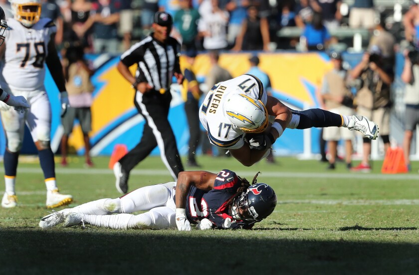Chargers quarterback Philip Rivers is upended by Houston Texans cornerback Bradley Roby after scrambling for a first down in the fourth quarter.