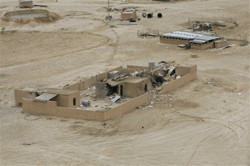 FILE - In this April 21, 2010 file photo, a general view of the site of a joint U.S-Iraqi raid on a safe house that killed Abu Omar al-Baghdadi and Abu Ayyub al-Masri, two top-ranking al-Qaida figures, about six miles (10 kilometers) southwest of Tikrit.  In an interview released Friday April 30, 2