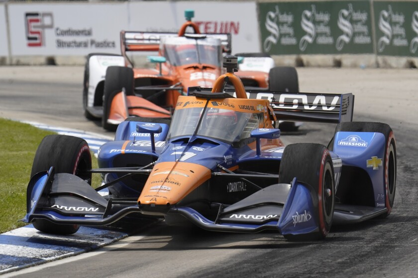 Felix Rosenqvist races during the first race of the IndyCar Detroit Grand Prix auto racing doubleheader on Belle Isle in Detroit Saturday, June 12, 2021. (AP Photo/Paul Sancya)