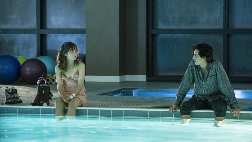 "(L-R) - Haley Lu Richardson and Cole Sprouse in ""FIVE FEET APART."" Credit: Alfonso Bresciani/CBS Fil"