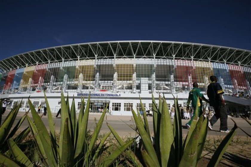 Soccer fans walk in front of Tundavala Stadium ahead of the start of African Cup of Nations Group D soccer matches in Lubango, Angola Wednesday, Jan. 13, 2010. (AP Photo/Rebecca Blackwell)