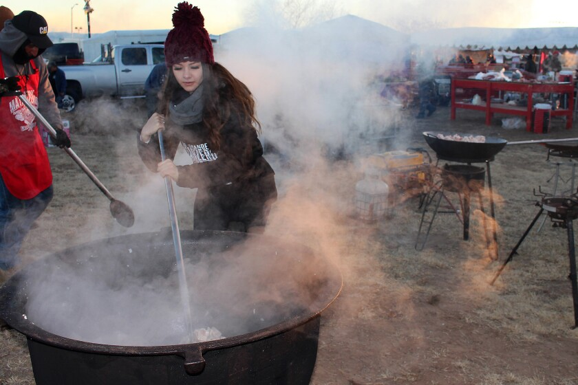 Alexis Guardian stirs chicharrones at the World's Largest Matanza, held Jan. 26 in Belen, New Mexico