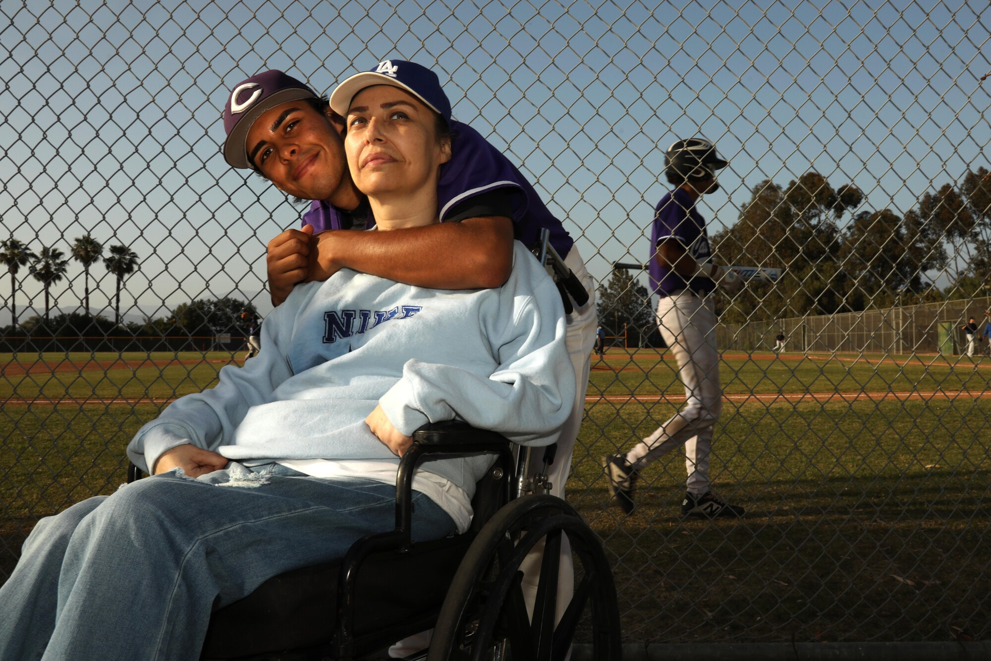 Cathedral High pitcher Geovanny Hernandez hugs his mom from behind her wheelchair